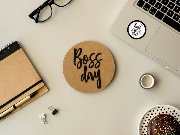 Flat lay sign with boss day on desk