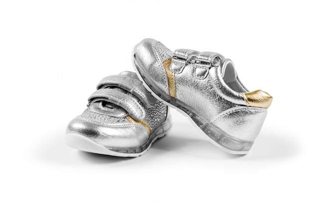 Flat lay. the silver children's sports shoes isolated