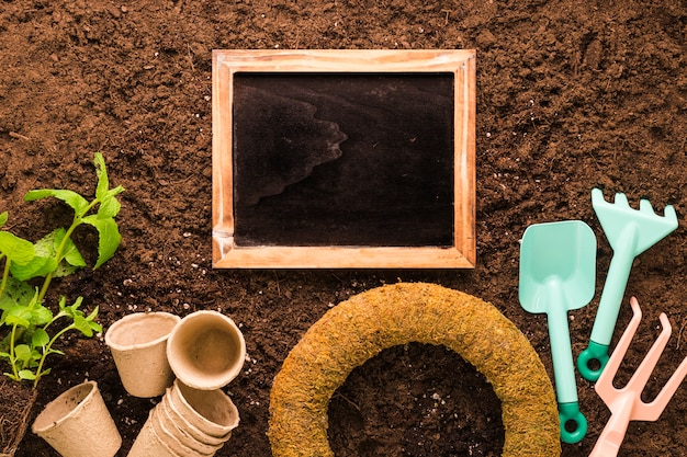 Flat lay of slate and gardening tools with copyspace