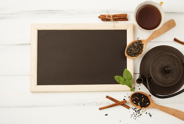 Flat lay slate template with tea concept