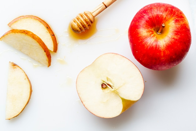 Flat lay sliced apple with honey