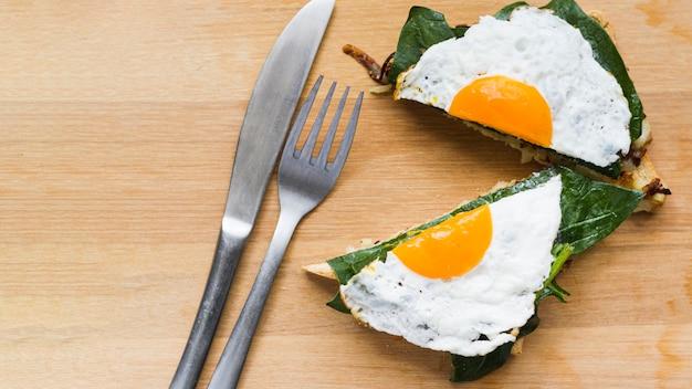 Flat lay sliced fried egg on waffle