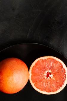 Flat lay sliced grapefruit
