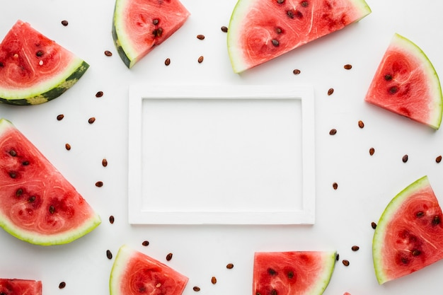 Flat lay sliced watermelon on white background with frame