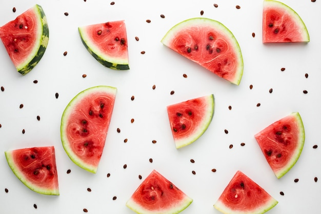 Flat lay sliced watermelon on white background