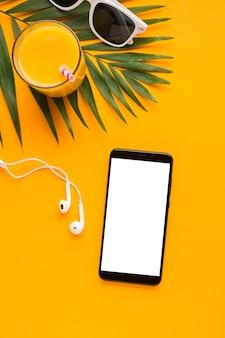 Flat lay smartphone beach concept