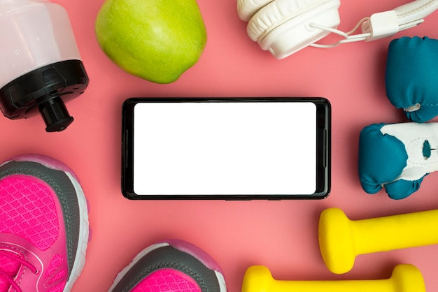 Flat lay of smartphone with sport essentials