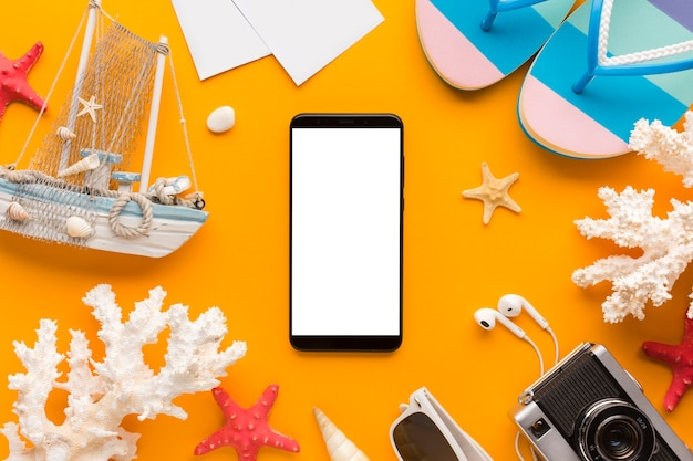 Flat lay smartphone with  summer vacation concept