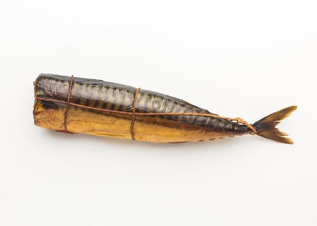 Flat lay smoked fish on white background