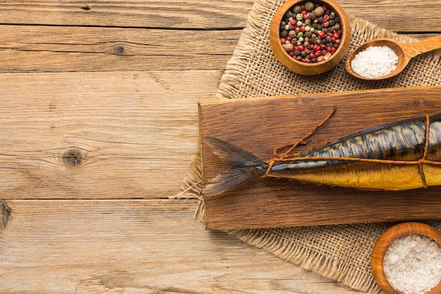 Flat lay smoked fish on wooden background