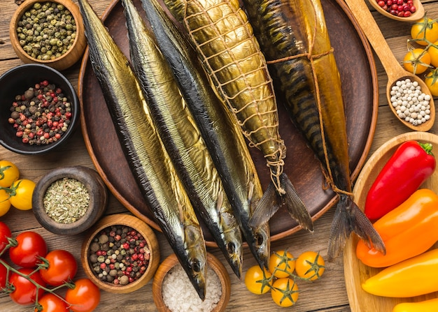 Flat lay smoked fishes on wooden table