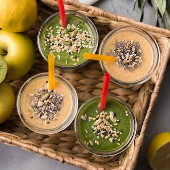 Flat lay smoothies in basket