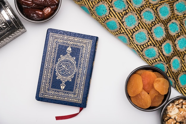 Flat lay snacks and quran on table