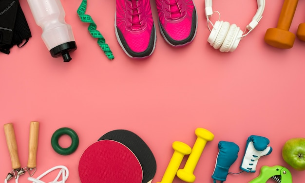 Flat lay of sneakers with gym essentials