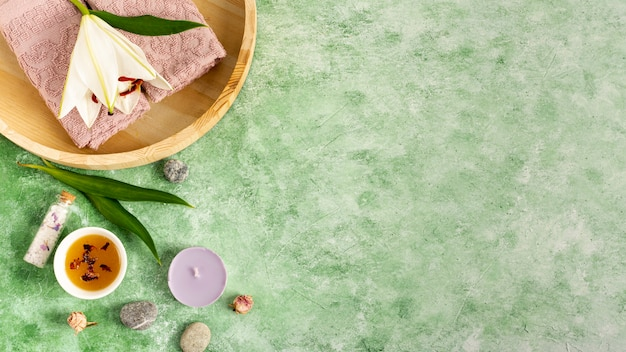 Flat lay spa arrangement on green background