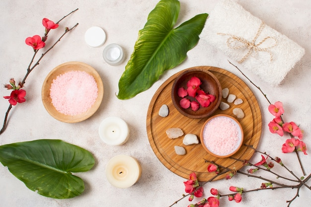 Flat lay spa composition with flowers and candles