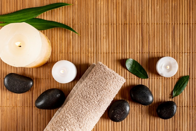 Flat lay spa concept with candles and stones