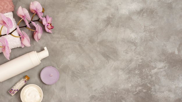 Flat lay spa frame on stucco background