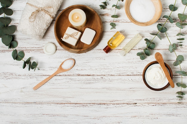 Flat lay spa products on wooden background