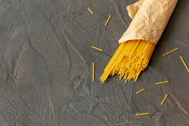 Flat lay of spaghetti on plain background