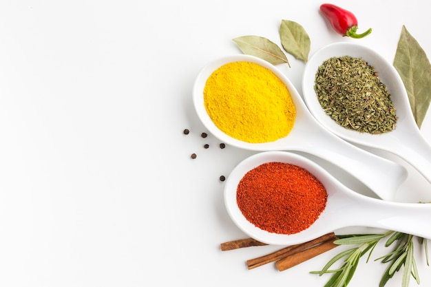 Flat lay spices powder on spoons