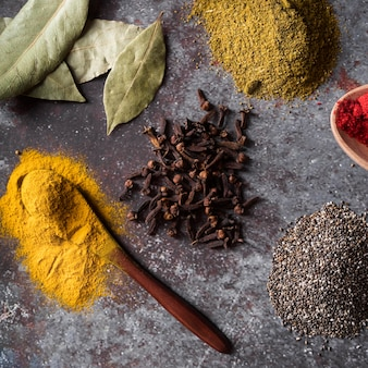 Flat lay spices on stucco background
