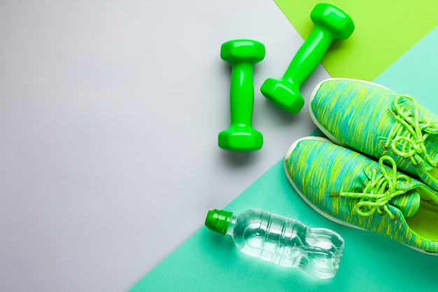Flat lay sports attributes with water bottle and shoes