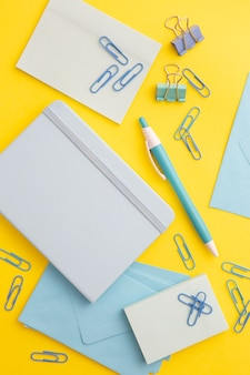Flat lay stationary composition on yellow background