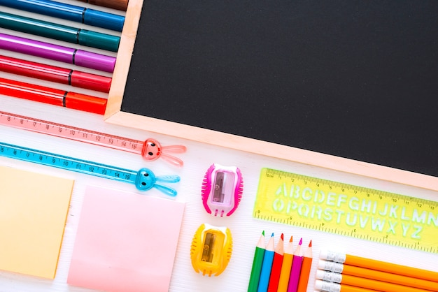 Flat-lay stationery chalk board on white of the table