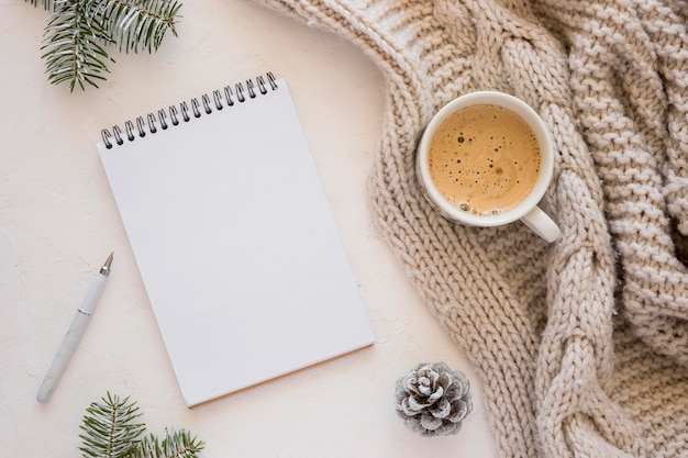Flat lay stationery empty papers and cup of coffee