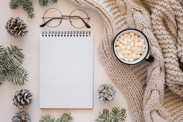 Flat lay stationery empty papers and reading glasses