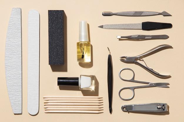 Плоский натюрморт ассортимент средств по уходу за ногтями