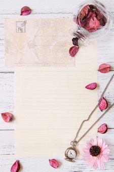 Flat lay stock photography purple flower petals letter envelope paper transparent glass bottle pocket clock