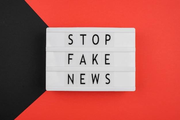 Flat lay stop fake news concept