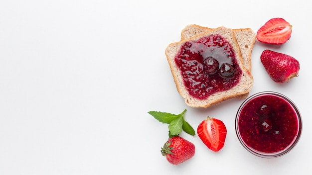 Flat lay strawberry jam on bread