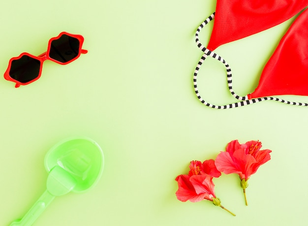 Flat lay of summer accessories and flowers