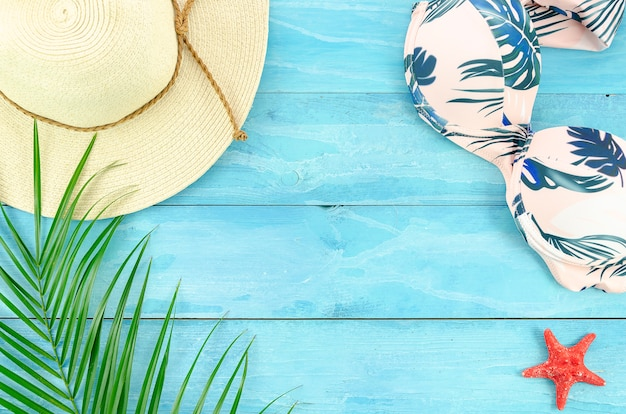 Flat lay summer background with palm leafs