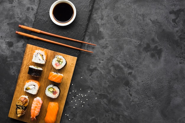 Flat lay sushi arrangement on slate background