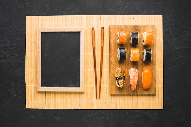 Flat lay sushi arrangement with black chalkboard