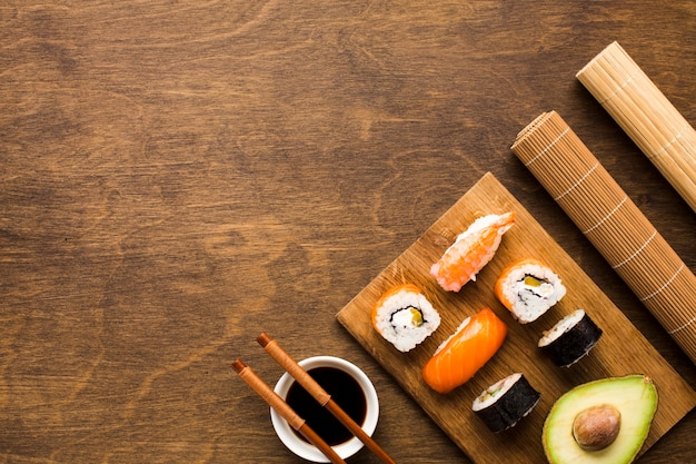 Flat lay sushi arrangement with copy space