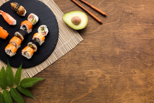 Flat lay sushi frame with copy space