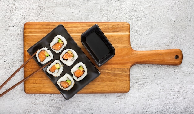 Flat lay sushi rolls with soy sauce
