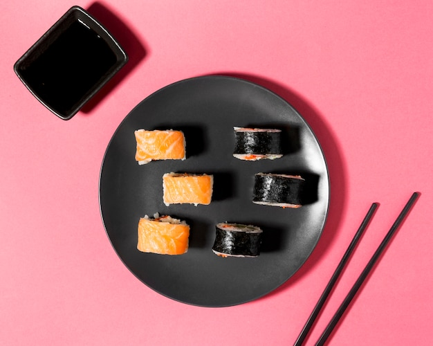Flat lay sushi variety with soy sauce