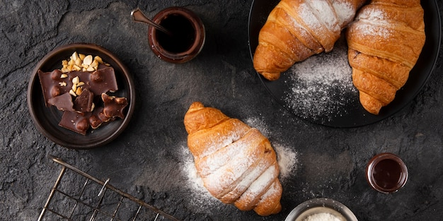 Flat lay sweet croissants arrangement