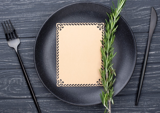 Flat lay table setting with blank paper sheet