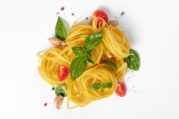 Flat lay of tagliatelle pasta on plain background