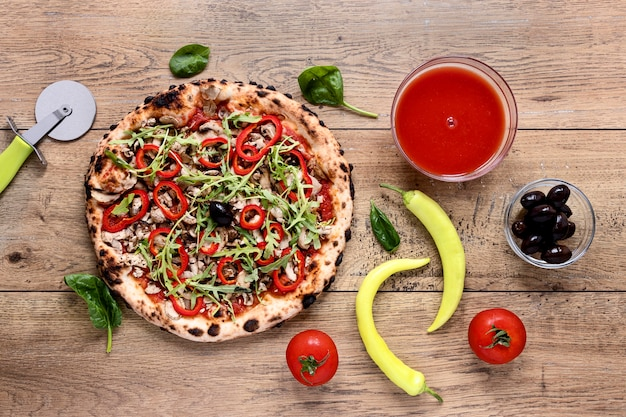 Flat lay tasty pizza on wooden background
