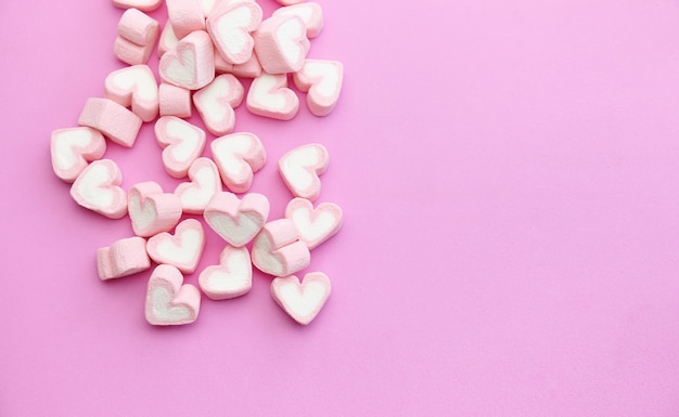 Flat lay template design top view pink marshmallows on sweet background with copy space