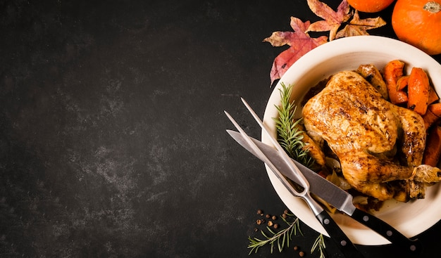 Flat lay of thanksgiving roasted chicken dish with copy space