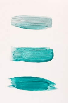 Flat lay of three blue paint brush strokes